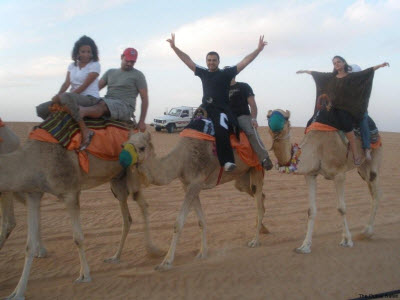 group enjoying camel riding